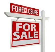 For sale sign from a foreclosure in Kissimmee, FL